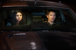 Ethan Hawke and what appears to be a 12 year old girl. In a car.